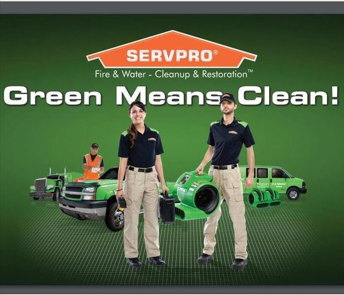 SERVPRO crew with equipment and vehicles